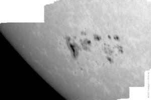 Complex sunspot group, faculae, limb darkening